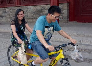 Hiring a tandem bicycle to ride around the city walls of Xian