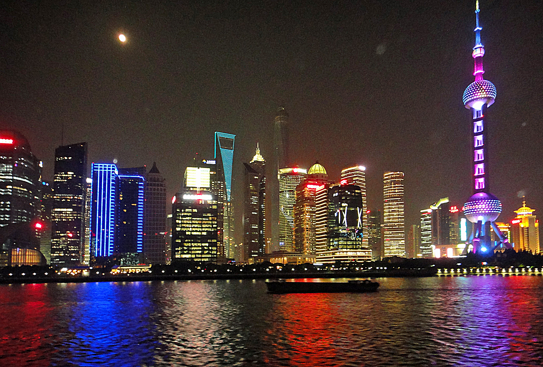 Shanghai at night: the Pearl of theOrient and the World Financial centre.